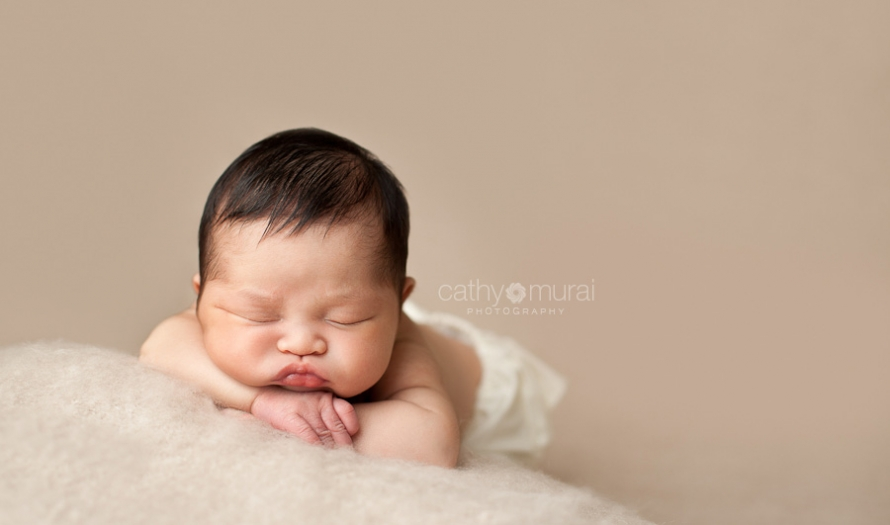 Precious Asian Newborn Baby Girl sleeping in the picture taken by Los Angeles (Alhambra) Newborn Photographer, Cathy Murai Photography