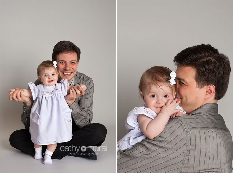7months old happy baby in beautiful light purple dress smiling with her father for their father and daughter