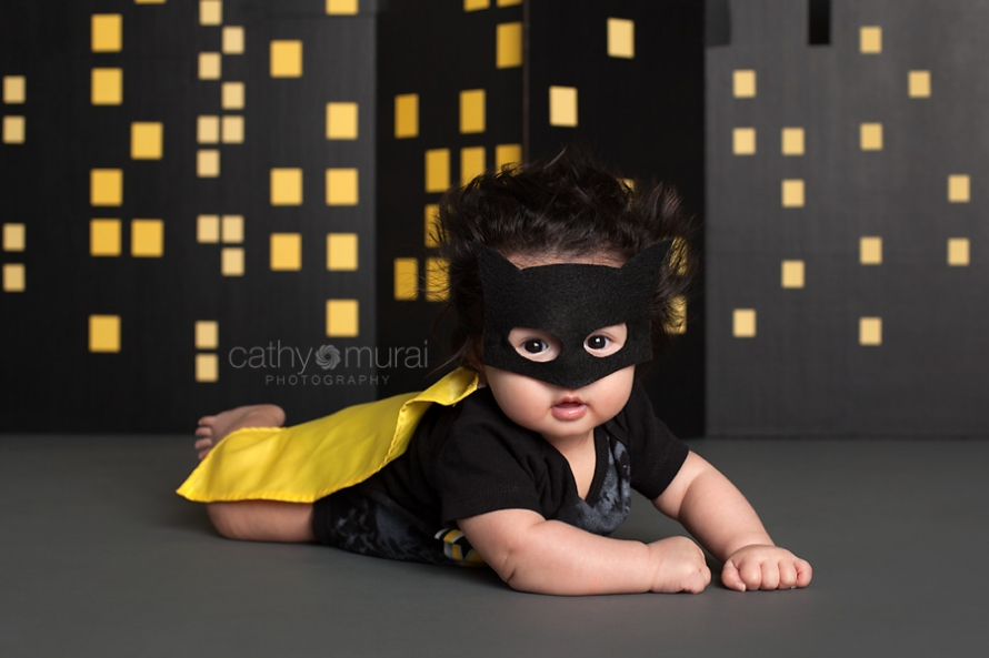 Baby Batman flying in front of the building at night to save the world, Superhero baby photography, 100 days old celebration, Asian Baby with a Batman costume, 3 months old baby portraits,  3 months old baby picture, 100 day old,  baby boy,  3 months old baby image, Cathy Murai Photography, Alhambra, Baby, Photographer, Photography, San Gabriel Valley, Los Angeles, Batman costume