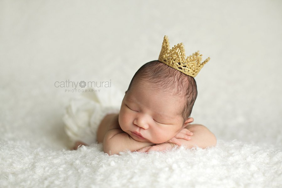 Asian 2 weeks newborn baby girl wearing a handmade gold lace crown and white diaper cover, posing and sleeping on white blanket.  Alhambra, San Gabriel Valley, Los Angeles, CA Studio Newborn Photographer, Cathy Murai Photography