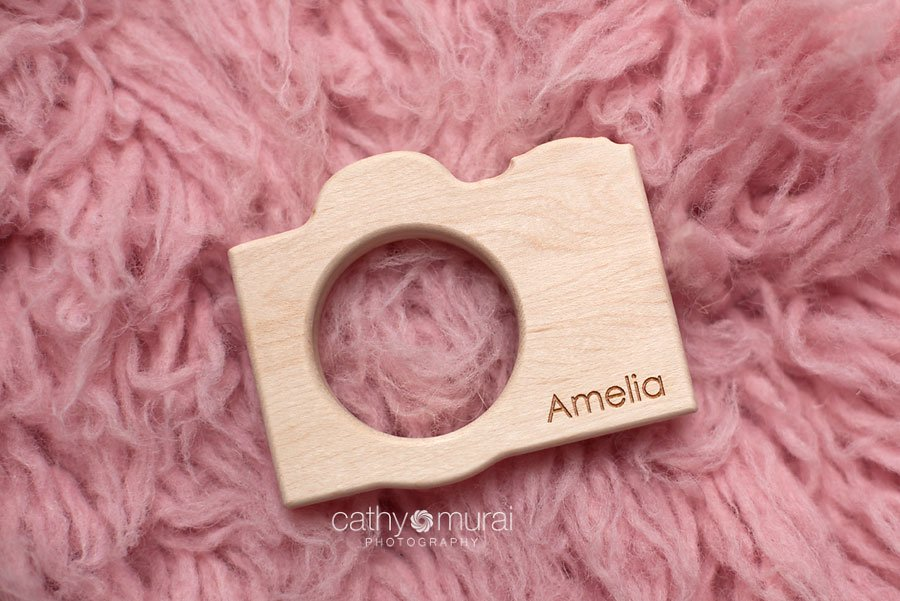 Personalized wooden camera - a teething toy from Little Spling Toys captured by Cathy Murai Photography