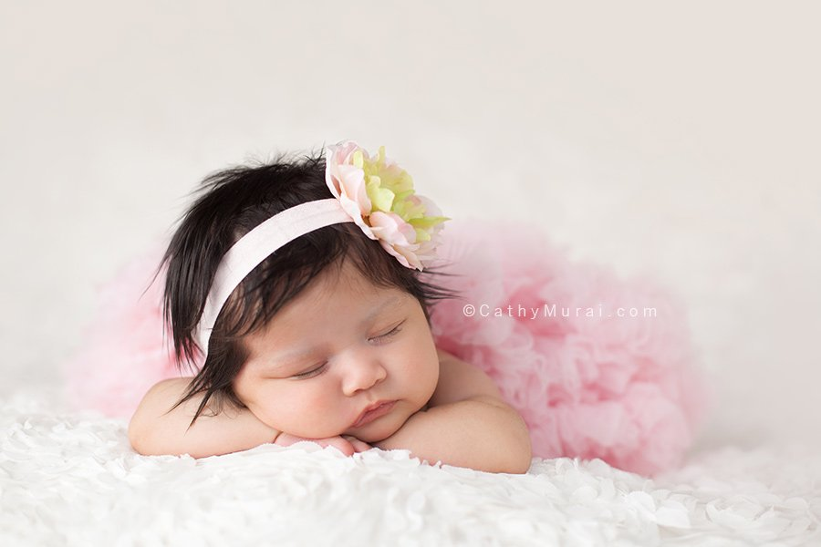 6 weeks old baby newborn baby girl wearing a pink pettiskirt petti skirt and