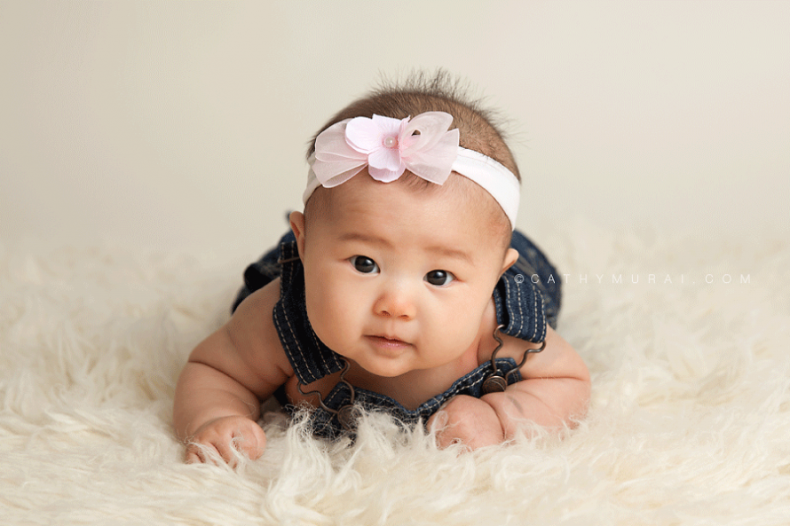 3 month old baby studio session, 3 month old Baby Sessions, 3 months old baby girl wearing pink headband and denim overall, tummy time