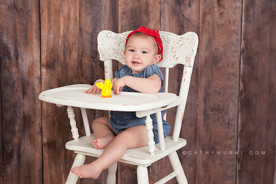 Alhambra San Gabriel San Marino Pasadena first Birthday Photographer Baby photographer Cute girl wearing denim cloth and red bandana for her first birthday portrait on white vintage high chair