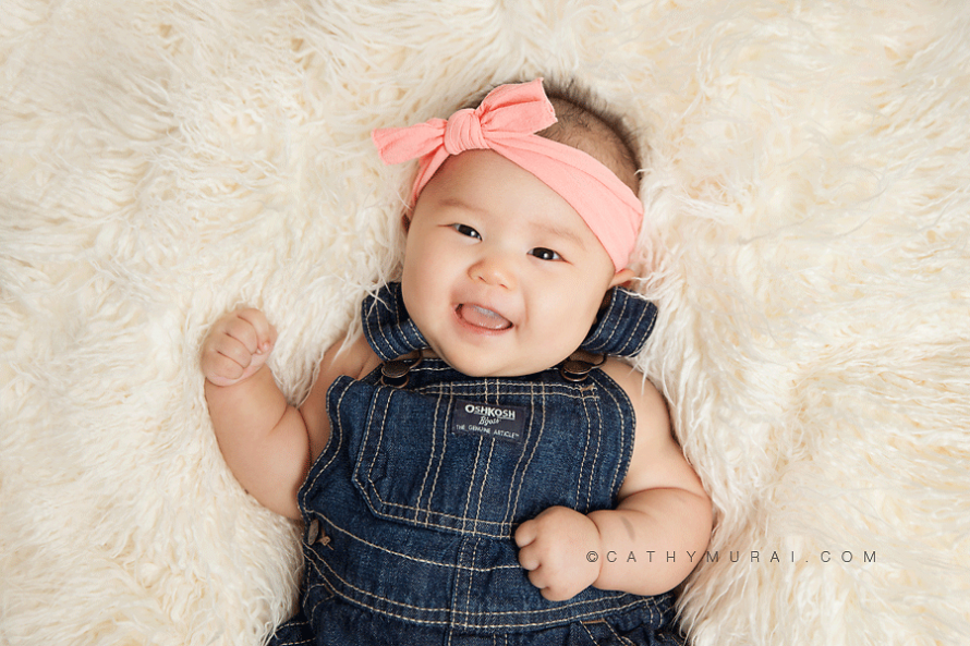 3 month old baby studio session, 3 month old Baby Session, 3 months old baby girl wearing pink headband and denim overall, smiling