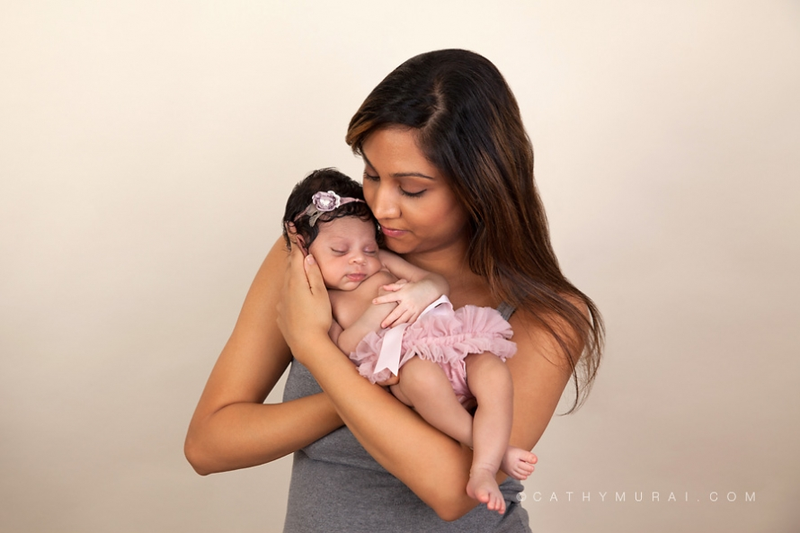 Mother and newborn baby portrait, Mother and newborn baby Photography, Mother and newborn baby picture, mommy and newborn picture, mom and newborn baby photo, mom and newborn baby photography, mom and newborn baby portraits,, mom and newborn photography, mom and newborn picture, mom and newborn baby girl photo, Indian newborn baby, newborn baby girl wearing pink diaper cover and pink head band sleeping in mom