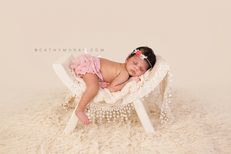 Indian newborn wearing pink headband and pink diaper cover sleeping on ivory curve bench on cream flokati rug, indian newborn baby, indian newborn baby girl, best newborn photographer,Los Angeles newborn baby photographer,Los Angeles newborn baby photography,famous baby photographer,famous newborn photographer,los angeles newborn photographer,los angeles newborn photography,los angeles newborn photographer,los angeles newborn photography,los angeles twin newborn photographer,los angeles twin newborn photography,newborn photo shoot los angeles,newborn photographer los angeles,newborn photographer alhambra,newborn photography los angeles, premier newborn photographer, Pasadena newborn baby photographer,Pasadena newborn photographer,San Gabriel Valley newborn photography,San Gabriel Valley newborn photographer,Alhambra newborn photography,top newborn photographer, Las Tunas newborn photography,Las Tunas newborn photographer, Cathy Murai Photography, newborn and sibling photographer, newborn and sibling photography, newborn and sibling pictures, newborn and sibling photos newborn and sibling pictures
