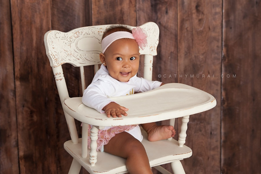 1st Birthday girl sitting on the white vintage high chair smiling. LOS ANGELES Birthday Portraits, LOS ANGELES 1st Birthday Portraits, LOS ANGELES first Birthday pictures, LOS ANGELES Birthday Photographer, LOS ANGELES Birthday Photography, LOS ANGELES first Birthday Photography, LOS ANGELES first Birthday Photographer, LOS ANGELES 1st Birthday Photographer, , LOS ANGELES 1st Birthday Photography, LOS ANGELES Baby Photographer, LOS ANGELES Baby Photography, LOS ANGELES Family Photographer, LOS ANGELES Family Photography, Los Angeles Smash Cake, Los Angles Cake Smash, LA Birthday Portaits, LA 1st Birthday Portarits, LA first Birthday pictures, LA Birthday Photographer, LA Birthday Photography, LA first Birthday Photographer, LA first Birthday Photography, LA Baby Photographer, LA Baby Photography, LA Family Photographer, LA Family Photography, LA Smash Cake, LA Cake Smash, PASADENA Birthday Portraits, PASADENA 1st Birthday Portraits, PASADENA first Birthday pictures, PASADENA Birthday Photographer, PASADENA Birthday Photography, PASADENA first Birthday Photography, PASADENA first Birthday Photographer, PASADENA 1st Birthday Photographer, , PASADENA 1st Birthday Photography, PASADENA Baby Photographer, PASADENA Baby Photography, PASADENA Family Photographer, PASADENA Family Photography, Pasadena Smash Cake, Los Angles Cake Smash, SAN GABIEL VALLEY Birthday Portraits, SAN GABIEL VALLEY 1st Birthday Portraits, SAN GABIEL VALLEY first Birthday pictures, SAN GABIEL VALLEY Birthday Photographer, SAN GABIEL VALLEY Birthday Photography, SAN GABIEL VALLEY first Birthday Photography, SAN GABIEL VALLEY first Birthday Photographer, SAN GABIEL VALLEY 1st Birthday Photographer, , SAN GABIEL VALLEY 1st Birthday Photography, SAN GABIEL VALLEY Baby Photographer, SAN GABIEL VALLEY Baby Photography, SAN GABIEL VALLEY Family Photographer, SAN GABIEL VALLEY Family Photography, San Gabiel Valley Smash Cake, Los Angles Cake Smash, ALHAMBRA Birthday Portraits, ALHAMBRA 1st Birthday Portrait