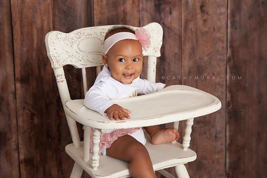 1st Birthday girl sitting on the white vintage high chair smiling. LOS ANGELES Birthday Portraits, LOS ANGELES 1st Birthday Portraits, LOS ANGELES first Birthday pictures, LOS ANGELES Birthday Photographer, LOS ANGELES Birthday Photography, LOS ANGELES first Birthday Photography, LOS ANGELES first Birthday Photographer, LOS ANGELES 1st Birthday Photographer, , LOS ANGELES 1st Birthday Photography, LOS ANGELES Baby Photographer, LOS ANGELES Baby Photography, LOS ANGELES Family Photographer, LOS ANGELES Family Photography, Los Angeles Smash Cake, Los Angles Cake Smash, LA Birthday Portaits, LA 1st Birthday Portarits, LA first Birthday pictures, LA Birthday Photographer, LA Birthday Photography, LA first Birthday Photographer, LA first Birthday Photography, LA Baby Photographer, LA Baby Photography, LA Family Photographer, LA Family Photography, LA Smash Cake, LA Cake Smash, PASADENA Birthday Portraits, PASADENA 1st Birthday Portraits, PASADENA first Birthday pictures, PASADENA Birthday Photographer, PASADENA Birthday Photography, PASADENA first Birthday Photography, PASADENA first Birthday Photographer, PASADENA 1st Birthday Photographer, , PASADENA 1st Birthday Photography, PASADENA Baby Photographer, PASADENA Baby Photography, PASADENA Family Photographer, PASADENA Family Photography, Pasadena Smash Cake, Los Angles Cake Smash, SAN GABIEL VALLEY Birthday Portraits, SAN GABIEL VALLEY 1st Birthday Portraits, SAN GABIEL VALLEY first Birthday pictures, SAN GABIEL VALLEY Birthday Photographer, SAN GABIEL VALLEY Birthday Photography, SAN GABIEL VALLEY first Birthday Photography, SAN GABIEL VALLEY first Birthday Photographer, SAN GABIEL VALLEY 1st Birthday Photographer, , SAN GABIEL VALLEY 1st Birthday Photography, SAN GABIEL VALLEY Baby Photographer, SAN GABIEL VALLEY Baby Photography, SAN GABIEL VALLEY Family Photographer, SAN GABIEL VALLEY Family Photography, San Gabiel Valley Smash Cake, Los Angles Cake Smash, ALHAMBRA Birthday Portraits, ALHAMBRA 1st Birthday Portraits, ALHAMBRA first Birthday pictures, ALHAMBRA Birthday Photographer, ALHAMBRA Birthday Photography, ALHAMBRA first Birthday Photography, ALHAMBRA first Birthday Photographer, ALHAMBRA 1st Birthday Photographer, , ALHAMBRA 1st Birthday Photography, ALHAMBRA Baby Photographer, ALHAMBRA Baby Photography, ALHAMBRA Family Photographer, ALHAMBRA Family Photography, Alhambra Smash Cake, Los Angles Cake Smash, SAN MARINOBirthday Portraits, SAN MARINO1st Birthday Portraits, SAN MARINOfirst Birthday pictures, SAN MARINOBirthday Photographer, SAN MARINOBirthday Photography, SAN MARINOfirst Birthday Photography, SAN MARINOfirst Birthday Photographer, SAN MARINO1st Birthday Photographer, , SAN MARINO1st Birthday Photography, SAN MARINOBaby Photographer, SAN MARINOBaby Photography, SAN MARINOFamily Photographer, SAN MARINOFamily Photography, San MarinoSmash Cake, Los Angles Cake Smash, TEMPLE CITYBirthday Portraits, TEMPLE CITY1st Birthday Portraits, TEMPLE CITYfirst Birthday pictures, TEMPLE CITYBirthday Photographer, TEMPLE CITYBirthday Photography, TEMPLE CITYfirst Birthday Photography, TEMPLE CITYfirst Birthday Photographer, TEMPLE CITY1st Birthday Photographer, , TEMPLE CITY1st Birthday Photography, TEMPLE CITYBaby Photographer, TEMPLE CITYBaby Photography, TEMPLE CITYFamily Photographer, TEMPLE CITYFamily Photography, Temple CitySmash Cake, Los Angles Cake Smash, ROSEMEADBirthday Portraits, ROSEMEAD1st Birthday Portraits, ROSEMEADfirst Birthday pictures, ROSEMEADBirthday Photographer, ROSEMEADBirthday Photography, ROSEMEADfirst Birthday Photography, ROSEMEADfirst Birthday Photographer, ROSEMEAD1st Birthday Photographer, , ROSEMEAD1st Birthday Photography, ROSEMEADBaby Photographer, ROSEMEADBaby Photography, ROSEMEADFamily Photographer, ROSEMEADFamily Photography, RosemeadSmash Cake, Los Angles Cake Smash, DOWNTOWN LOS ANGELES Birthday Portraits, DOWNTOWN LOS ANGELES 1st Birthday Portraits, DOWNTOWN LOS ANGELES first Birthday pictures, DOWNTOWN LOS ANGELES Birthday Photographer, DOWNTOWN LOS ANGELES Birthday Photography, DOWNTOWN LOS ANGELES first Birthday Photography, DOWNTOWN LOS ANGELES first Birthday Photographer, DOWNTOWN LOS ANGELES 1st Birthday Photographer, , DOWNTOWN LOS ANGELES 1st Birthday Photography, DOWNTOWN LOS ANGELES Baby Photographer, DOWNTOWN LOS ANGELES Baby Photography, DOWNTOWN LOS ANGELES Family Photographer, DOWNTOWN LOS ANGELES Family Photography, Downtown Los Angeles Smash Cake, Los Angles Cake Smash