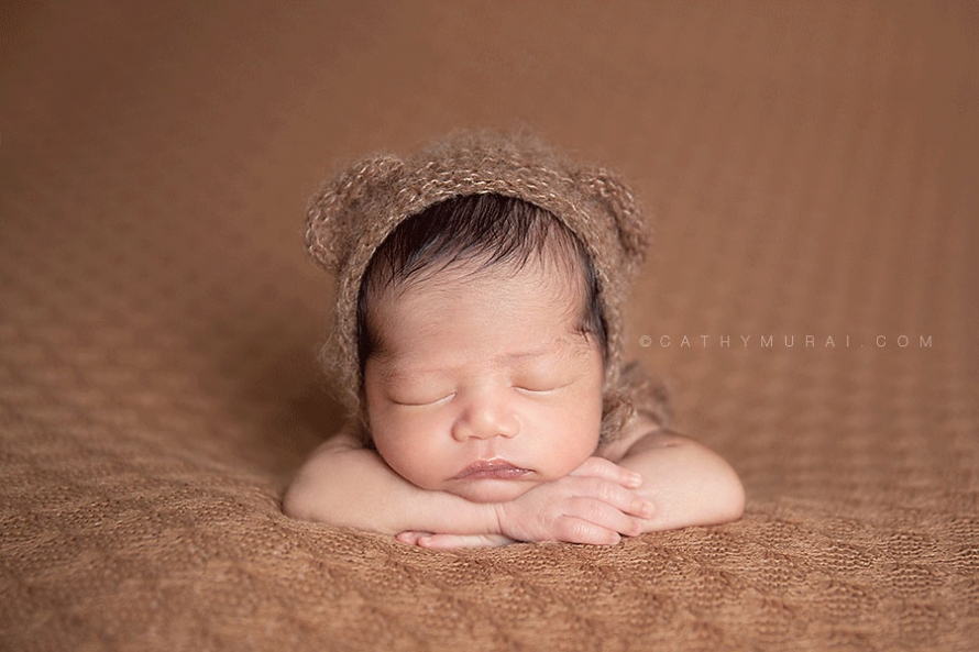 Newborn baby boy wearing a teddy bear hat, sleeping on his both arms, Los Angeles Newborn Photographer, Alhambra newborn photographer, San Gabriel Valley newborn photographer, newborn picture, newborn image, newborn portrait, newborn studio photography, newborn photography, Cathy Murai Photography