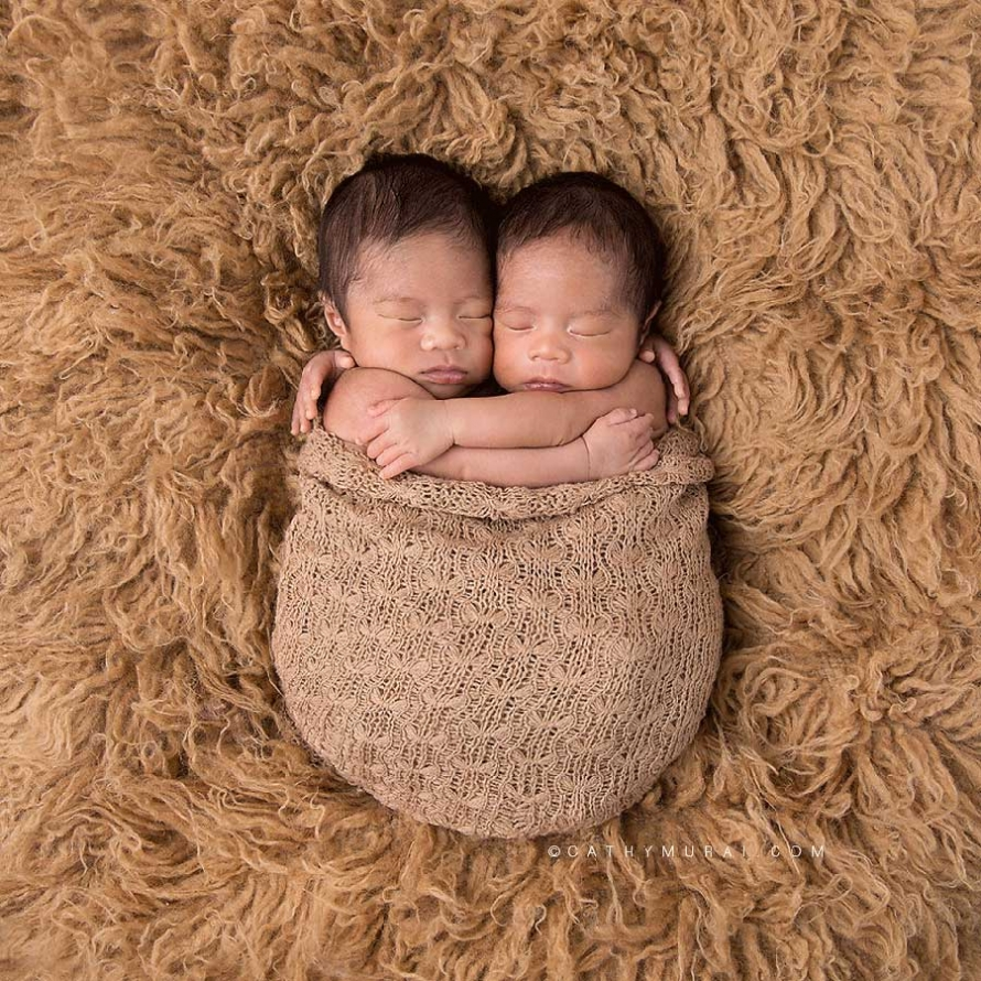 identical twin boys_newborn twins_holding arms while sleeping _wrapped with brown wrap_brown flokati rug_cream scarf on the wooden floor_twins newborn portrait session, Newborn Twins Photography, Newborn Twins Photographer, los angeles newborn photo studio, LOS ANGELES Newborn twins Portraits, LOS ANGELES Newborn twins pictures, LOS ANGELES Newborn twins Images, LOS ANGELES Newborn twins Photographer, LOS ANGELES Newborn twins Photography, LOS ANGELES Newborn twins Studio Photographer, LOS ANGELES Newborn twins Studio Photography, Los Angeles the best Newborn twins photographer, LOS ANGELES Newborn twins and Family Photographer, LOS ANGELES Newborn twins and Family Photography, Los Angeles Newborn twins Posing Photography, Los Angeles Newborn twins and Siblings Photography, Los Angeles Newborn twins and Siblings Photographer, Los Angeles the best Newborn twins Photographer, Los Angeles Japanese Newborn twins Photographer, LOS ANGELES Professional Newborn twins Photography, LOS ANGELES Professional Newborn twins Photographer, Los Angeles Newborn twins Photo Studio ALHAMBRA Newborn twins Portraits, ALHAMBRA Newborn twins pictures, ALHAMBRA Newborn twins Images, ALHAMBRA Newborn twins Photographer, ALHAMBRA Newborn twins Photography, ALHAMBRA Newborn twins Studio Photographer, ALHAMBRA Newborn twins Studio Photography, Alhambra the best Newborn twins photographer, ALHAMBRA Newborn twins and Family Photographer, ALHAMBRA Newborn twins and Family Photography, Alhambra Newborn twins Posing Photography, Alhambra Newborn twins and Siblings Photography, Alhambra Newborn twins and Siblings Photographer, Alhambra the best Newborn twins Photographer, Alhambra Japanese Newborn twins Photographer, SAN MARINO Newborn twins Portraits, SAN MARINO Newborn twins pictures, SAN MARINO Newborn twins Images, SAN MARINO Newborn twins Photographer, SAN MARINO Newborn twins Photography, SAN MARINO Newborn twins Studio Photographer, SAN MARINO Newborn twins Studio Photography, SAN MARINO the 