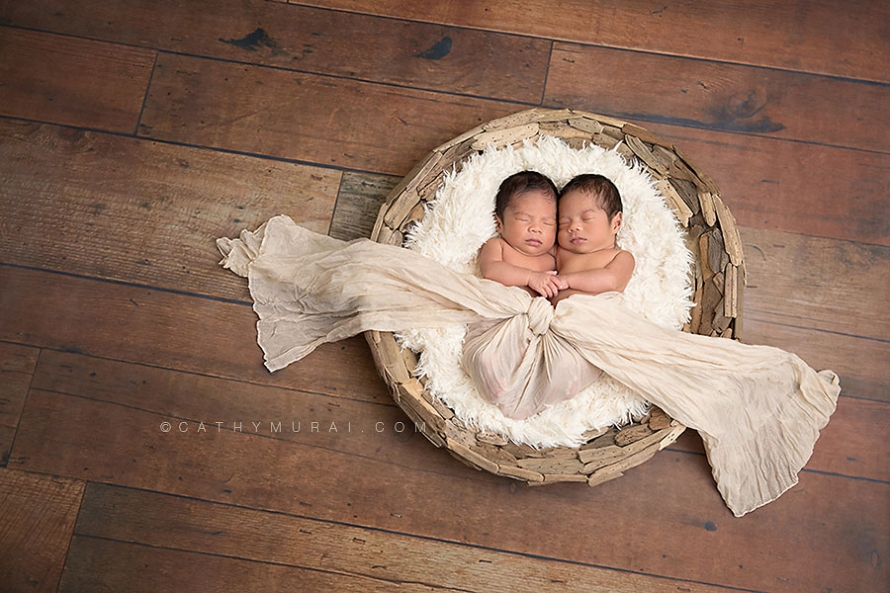 identical twin boys_newborn twins_holding hands while sleeping in the round wooden basket with cream fur and cream scarf on the wooden floor_twins newborn portrait session, Newborn Twins Photography, Newborn Twins Photographer, los angeles newborn photo studio, LOS ANGELES Newborn twins Portraits, LOS ANGELES Newborn twins pictures, LOS ANGELES Newborn twins Images, LOS ANGELES Newborn twins Photographer, LOS ANGELES Newborn twins Photography, LOS ANGELES Newborn twins Studio Photographer, LOS ANGELES Newborn twins Studio Photography, Los Angeles the best Newborn twins photographer, LOS ANGELES Newborn twins and Family Photographer, LOS ANGELES Newborn twins and Family Photography, Los Angeles Newborn twins Posing Photography, Los Angeles Newborn twins and Siblings Photography, Los Angeles Newborn twins and Siblings Photographer, Los Angeles the best Newborn twins Photographer, Los Angeles Japanese Newborn twins Photographer, LOS ANGELES Professional Newborn twins Photography, LOS ANGELES Professional Newborn twins Photographer, Los Angeles Newborn twins Photo Studio ALHAMBRA Newborn twins Portraits, ALHAMBRA Newborn twins pictures, ALHAMBRA Newborn twins Images, ALHAMBRA Newborn twins Photographer, ALHAMBRA Newborn twins Photography, ALHAMBRA Newborn twins Studio Photographer, ALHAMBRA Newborn twins Studio Photography, Alhambra the best Newborn twins photographer, ALHAMBRA Newborn twins and Family Photographer, ALHAMBRA Newborn twins and Family Photography, Alhambra Newborn twins Posing Photography, Alhambra Newborn twins and Siblings Photography, Alhambra Newborn twins and Siblings Photographer, Alhambra the best Newborn twins Photographer, Alhambra Japanese Newborn twins Photographer, SAN MARINO Newborn twins Portraits, SAN MARINO Newborn twins pictures, SAN MARINO Newborn twins Images, SAN MARINO Newborn twins Photographer, SAN MARINO Newborn twins Photography, SAN MARINO Newborn twins Studio Photographer, SAN MARINO Newborn twins Studio Photography, SAN MARINO 