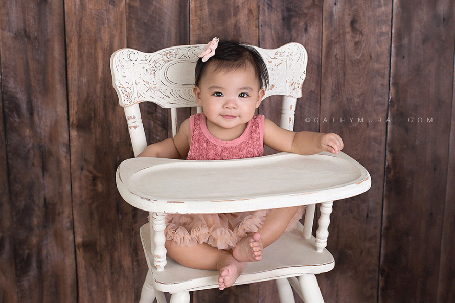 First Birthday Portraits, first birthday girl sitting on the white vintage high chair in front of the wooden backdrop, LOS ANGELES Birthday Portraits, LOS ANGELES 1st Birthday Portraits, LOS ANGELES first Birthday Portraits, LOS ANGELES 1st Birthday pictures, LOS ANGELES first Birthday pictures, LOS ANGELES Birthday pictures, LOS ANGELES 1st Birthday Photography, LOS ANGELES first Birthday Photography, LOS ANGELES Birthday Photography, LOS ANGELES first Birthday Photographer, LOS ANGELES 1st Birthday Photographer, LOS ANGELES Birthday Photographer, LOS ANGELES Baby Photographer, LOS ANGELES Baby Photography, LOS ANGELES Baby Photographer, Los Angeles Smash Cake, Los Angles Cake Smash, LA Birthday Portaits, LA 1st Birthday Portarits, LA first Birthday pictures, LA Birthday Photographer, LA Birthday Photography, LA first Birthday Photographer, LA first Birthday Photography, LA Baby Photographer, LA Baby Photography, LA Family Photographer, LA Family Photography, LA Smash Cake, LA Cake Smash, PASADENA Birthday Portraits, PASADENA 1st Birthday Portraits, PASADENA first Birthday pictures, PASADENA Birthday Photographer, PASADENA Birthday Photography, PASADENA first Birthday Photography, PASADENA first Birthday Photographer, PASADENA 1st Birthday Photographer, , PASADENA 1st Birthday Photography, PASADENA Baby Photographer, PASADENA Baby Photography, PASADENA Family Photographer, PASADENA Family Photography, Pasadena Smash Cake, Los Angles Cake Smash, SAN GABIEL VALLEY Birthday Portraits, SAN GABIEL VALLEY 1st Birthday Portraits, SAN GABIEL VALLEY first Birthday pictures, SAN GABIEL VALLEY Birthday Photographer, SAN GABIEL VALLEY Birthday Photography, SAN GABIEL VALLEY first Birthday Photography, SAN GABIEL VALLEY first Birthday Photographer, SAN GABIEL VALLEY 1st Birthday Photographer, , SAN GABIEL VALLEY 1st Birthday Photography, SAN GABIEL VALLEY Baby Photographer, SAN GABIEL VALLEY Baby Photography, SAN GABIEL VALLEY Family Photographer, SAN GABIEL VALLEY Family Photo