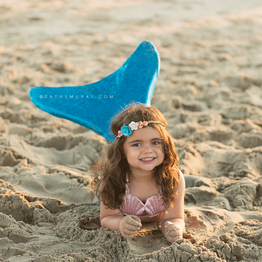 The Little Mermaid Themed Birthday Photography, 3 year old birthday girl wearing little mermaid costume laying on the sand on the beach showing her turquoise color tail during her birthday photo session, Disney inspired, the little mermaid, beach session, Manhattan Beach, Disney's little mermaid, Mermaid Photography Prop, toddler mermaid photography, disney inspired photography, little mermaid inspired birthday photography, little mermaid inspired birthday photos, little mermaid inspired birthday pictures, little mermaid inspired birthday portraits, mermaid tail, Every little girl dreams of being a Mermaid, little mermaid beach session, turquoise mermaid tail, LOS ANGELES Birthday Portraits, LOS ANGELES Birthday pictures, LOS ANGELES Birthday Photographer, LOS ANGELES Birthday Photography, LOS ANGELES Toddler Photographer, LOS ANGELES Toddler Photography, LOS ANGELES Child Photography, LA Birthday Portraits, LA Birthday pictures, LA Birthday Photographer, LA Birthday Photography, LA Toddler Photographer, LA Toddler Photography, LA Child Photography, SAN GABRIEL Birthday Portraits, SAN GABRIEL Birthday pictures, SAN GABRIEL Birthday Photographer, SAN GABRIEL Birthday Photography, SAN GABRIEL Toddler Photographer, SAN GABRIEL Toddler Photography, ALHAMBRA Birthday Portraits, ALHAMBRA Birthday pictures, ALHAMBRA Birthday Photographer, ALHAMBRA Birthday Photography, ALHAMBRA Toddler Photographer, ALHAMBRA Toddler Photography, SAN MARINO Birthday Portraits, SAN MARINO Birthday pictures, SAN MARINO Birthday Photographer, SAN MARINO Birthday Photography, SAN MARINO Toddler Photographer, SAN MARINO Toddler Photography, SOUTH PASADENA Birthday Portraits, SOUTH PASADENA Birthday pictures, SOUTH PASADENA Birthday Photographer, SOUTH PASADENA Birthday Photography, SOUTH PASADENA Toddler Photographer, SOUTH PASADENA Toddler Photography, PASADENA Birthday Portraits, PASADENA Birthday pictures, PASADENA Birthday Photographer, PASADENA Birthday Photography, PASADENA Toddler Photogr