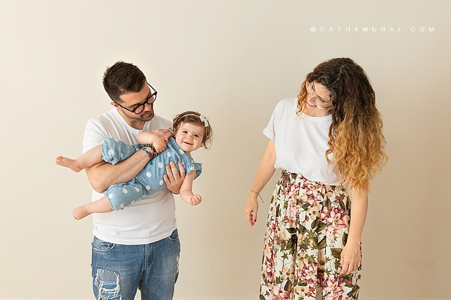 A candid shot of a family portrait in the studio - natural family photography