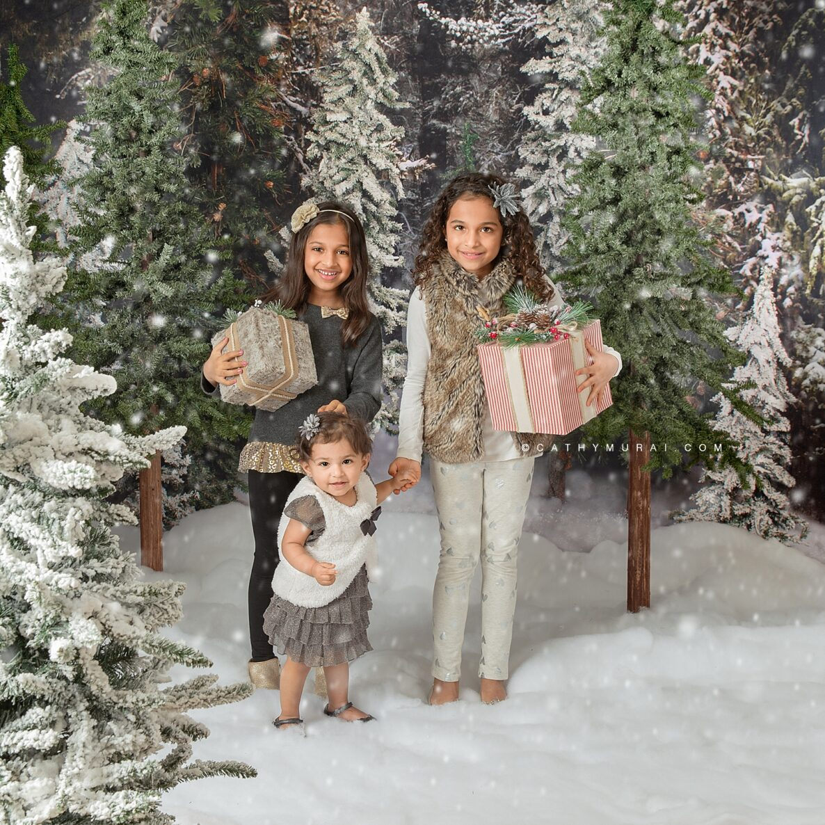 Orange County holiday portrait mini session let it snow siblings holiday photo at snowing Christmas tree farm taken in Irvine, CA